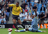 Photo: Paul Thomas.<br /> Manchester City v Arsenal. The Barclays Premiership. 26/08/2006.<br /> <br /> Thierry Henry (L) of Arsenal takes a run past Trevor Sinclair's tackle.