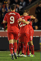 Liverpool's Steven Gerrard celebrates with his team mates after scoring. - Photo mandatory by-line: Dougie Allward/JMP - Mobile: 07966 386802 - 05/01/2015 - SPORT - football - London - Cherry Red Records Stadium - AFC Wimbledon v Liverpool - FA Cup - Third Round