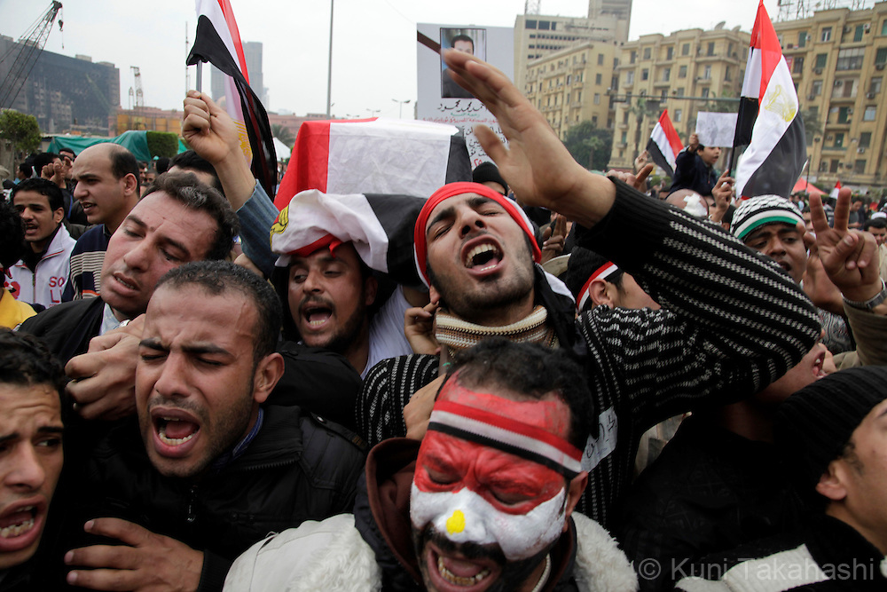 People carry a symbolic coffin of Egyptian journalist Ahmed Mohammed Mahmoud, in symbolic funeral ceremony in Tahrir Square, Cairo, Egypt, Monday, Feb. 7, 2011. The reporter who was shot during clashes a week ago died of his wounds Friday in the first reported death of a journalist in the chaos surrounding Egypt's anti-government protests. .Photo by Kuni Takahashi