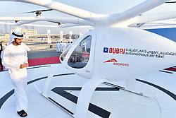 Dubai Crown Prince Sheikh Hamdan bin Mohammed Al Maktoum (center), attends presentation and first flight of the Volocopter 2X used as Autonomous Air Taxi, in Dubai, United Arab Emirates, on September 25, 2017. It is a drone that will be the world's first self-flying taxi service set to be introduced by Dubai's Road and Transport Authority (RTA), in the coming years. The two-seater vehicle, is capable of transporting people without human intervention or a pilot, and is supplied by Volocopter, a Germany-based specialist manufacturer of autonomous air vehicles. Photo by Balkis Press/ABACAPRESS.COM