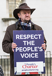 PLACE, January 14 2018. A few dozen protesters from 'The People's Charter' group demonstrate outside Downing Street demanding that the Brexit referendum result is respected following calls for a second referendum. PICTURED: A protester's placard demands that the people's voice is respected. © Paul Davey