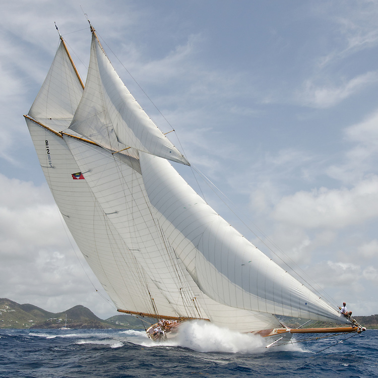 """ELENA.<br /> <br /> Back in the 60s, classic yachts, which were gathered in English Harbour Antigua, had begun chartering and the captains and crews challenged each other to a race down to Guadeloupe and back to celebrate the end of the charter season. From this informal race, Antigua Race Week was formalised in 1967, and in those days all of the yachts were classics. As the years grew on, the classic yachts were slowly outnumbered but the faster sleeker modern racing yachts and 24 years later the Classic Class had diminished to a few boats and was abandoned in 1987. However this same year seven classic yachts turned out and were placed in Cruising Class 3 with the bare boats. The class was so unmatched that it was downright dangerous, so Captain Uli Pruesse hosted a meeting onboard Aschanti of Saba with several classic skippers and in 1988 the Antigua Classic Yacht Regatta was born, with seven boats.<br /> <br /> In 1991, Elizabeth Meyer brought her newly refitted Endeavour and Baron Edmond Rothschild brought his 6-meter Spirit of St Kitts and """"CSR"""" became the first Sponsor and inaugurated the Concours d'Elégance. In 1996 we created the """"Spirit of Tradition Class"""", which has now been accepted all over the world, which gives the """"new"""" classics, built along the lines of the old, a chance to sail alongside their sister ships. In 1999 we celebrated the first race between the J class yachts in 60 years. Mount Gay Rum has sponsored the Regatta for many years, and we have recently added Officine Panerai as our first ever Platinum Sponsor.<br /> <br /> The Antigua Classic Yacht Regatta has maintained a steady growth, hosting between 50 and 60 yachts every year and enjoys a wonderful variety of competitors, including traditional craft from the islands, classic ketches, sloops, schooners and yawls making the bulk of the fleet, together with the stunningly beautiful Spirit of Tradition yachts, J Class yachts and Tall Ships."""