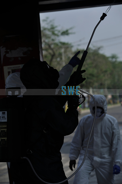 Medan, Indonesia, March 28, 2020: Indonesian police personnel seen during make an daily socialization and disinfection of the Corona Virus Disease 19 spread dangers in Medan, North Sumatra province, Indonesia on March 28, 2020.