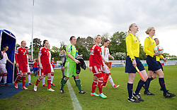 BANGOR, WALES - Thursday, May 8, 2014: Wales' captain Jessica Fishlock leads her side out to face Montenegro during the FIFA Women's World Cup Canada 2015 Qualifying Group 6 match at the Nantporth Stadium. (Pic by David Rawcliffe/Propaganda)