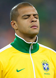 Felipe Melo of Brazil listening to the national anthem during the 2010 FIFA World Cup South Africa Group G Second Round match between Brazil and République de Côte d'Ivoire on June 20, 2010 at Soccer City Stadium in Soweto, suburban Johannesburg, South Africa.  Brazil defeated Ivory Coast 3-1. (Photo by Vid Ponikvar / Sportida)