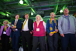 © Licensed to London News Pictures . 25/09/2015 . Doncaster , UK . People sing the British National Anthem at the start of the 2015 UKIP Party Conference at Doncaster Racecourse , this morning (Friday 25th September 2015) . Photo credit : Joel Goodman/LNP