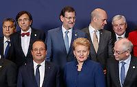(L-R 1st row) French President Francois Hollande, Lithuanian President Dalia Grybauskaite, European Council President Herman Van Rompuy, (2nd row) Hungarian Prime Minister Viktor Orban, Belgian Prime Minister Elio Di Rupo, Spanish Prime Minister Mariano Rajoy, Swedish Prime Minister Fredrik Reinfeldt, Czech Prime Minister Jiri Rusnok pose for a family photo during an European Union summit in Brussels, Belgium, 24 October 2013.