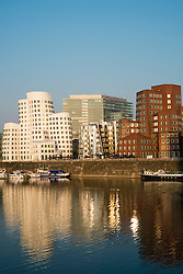 Neuer Zollhof buildings designed by Frank Gehry in Medienhafen or Media Harbour in Düsseldorf Germany