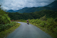 A man rides a motorbike on a side road, Muong La District, Son La Province, Vietnam, Southeast Asia