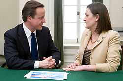 Leader of the Conservative Party David Cameron with Rebecca Harris, Member of Parliament for Castle Point in his office in Norman Shaw South, January 7, 2010. Photo By Andrew Parsons / i-Images.
