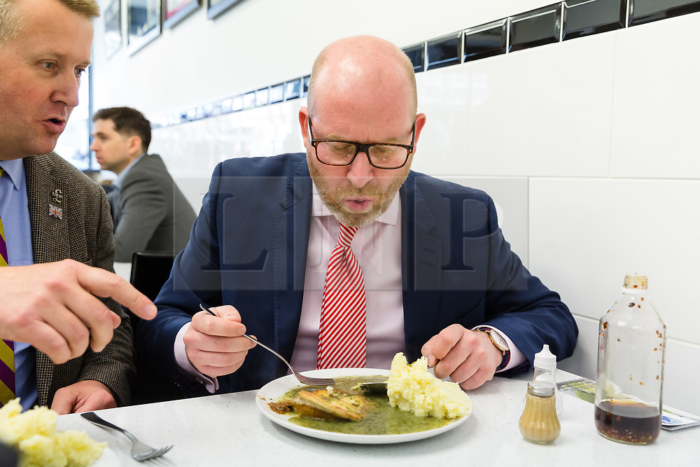 © Licensed to London News Pictures. 20/05/2017. LONDON, UK.  PAUL NUTTALL, UKIP leader takes a break to eat in a pie and mash shop in Elm Park after campaigning with UKIP candidate for Dagenham and Rainham, Peter Harris. All political parties continue to campaign across the UK ahead of the general election taking place on 8th June. Photo credit: Vickie Flores/LNP