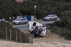 January 30, 2018 - Hossegor, France - Agnes boat being pulled off beach. Fears are growing for the multi-millionaire boss of American sports giant Quiksilver after his empty powerboat was found upside down on an isolated French beach. PIERRE AGNES, the 54-year-old father of three who is the company's CEO, was reportedly last seen setting out in rough seas early on Tuesday morning. The Frenchman was alone on board the 11 metre 'Mascaret III' as it headed off into the Atlantic close to the seaside resort of Biarritz. (Credit Image: © Panoramic via ZUMA Press)
