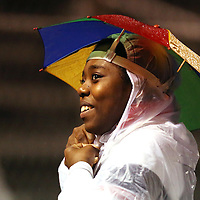 Lauren Wood   Buy at photos.djournal.com<br /> Me'Iaya Cummings sports an umbrella hat while cheering for the Bearcats on the sidelines during Friday night's game against Eupora.