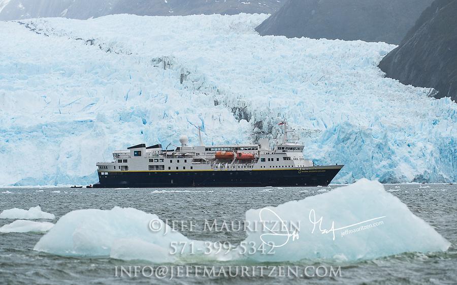 The National Geographic Explorer expedition ship in front of Garibaldi Glacier in Parque Nacional Alberto de Agostini, Chile.