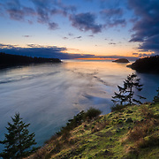 A clearing winter storm over the western waters of Deception Pass State Park in Washington State.