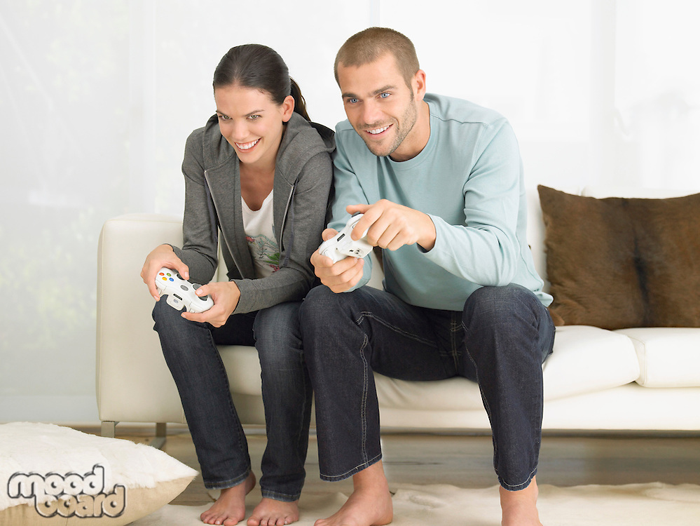 Couple on Sofa Playing Video Game