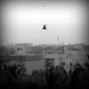 Early morning in Karachi. An army helicopter is flying circle round.