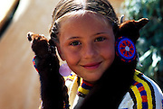 THIS PHOTO IS AVAILABLE FOR WEB DOWNLOAD ONLY. PLEASE CONTACT US FOR A LARGER PHOTO. Native American Indian girl with fur braid covers.  MR