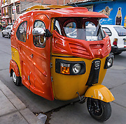 A mototaxi (three-wheeled auto rickshaw) provides cheap public transportation in Huaraz, in the Santa Valley (Callejon de Huaylas), Ancash Region, Peru, South America.