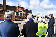 Council Leader Stephen Alambritis (far left) AFC Wimbledon legend Ian Cooke (centre), Chief Executive Erik Samuelson (right) and children from both Smallwood Primary School and children from AFC Wimbledon player development programme during the AFC Wimbledon Demolition Event, marking the start of building works at the AFC Wimbledon Stadium Site, Plough Lane, United Kingdom on 16 March 2018. Picture by Stephen Wright.