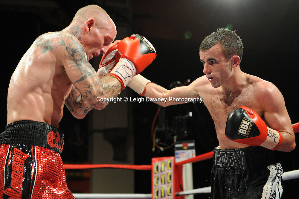 Chris Edwards (red/black shorts) defeats Paul Edwards for the British Flyweight Title at Olympia, Liverpool on the 11th June 2011. Frank Maloney Promotions.Photo credit: Leigh Dawney 2011