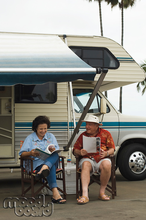 Couple Relaxing Outside Their RV