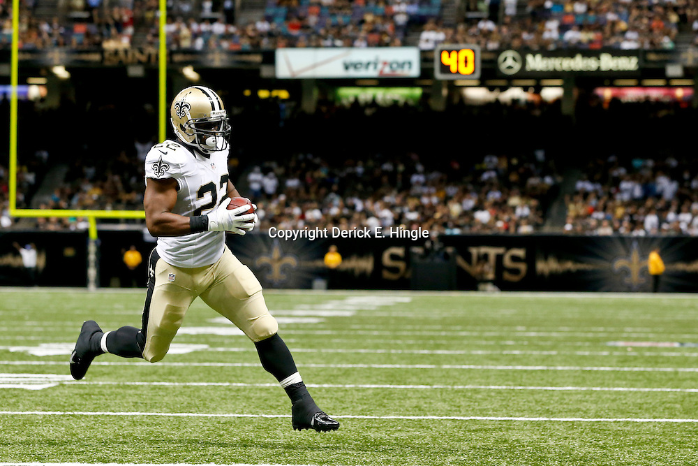 Aug 16, 2013; New Orleans, LA, USA; New Orleans Saints running back Mark Ingram (22) run in for a touchdown against the Oakland Raiders during the first quarter of a preseason game at the Mercedes-Benz Superdome. Mandatory Credit: Derick E. Hingle-USA TODAY Sports