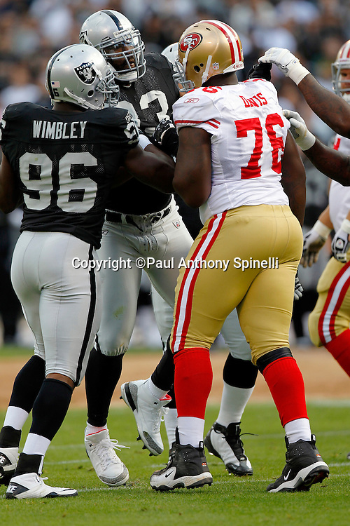 Oakland Raiders linebacker Kamerion Wimbley (96) breaks up a scuffle between Raiders defensive tackle Tommy Kelly (93) and San Francisco 49ers rookie offensive tackle Anthony Davis (76) during the NFL preseason week 3 football game against the San Francisco 49ers on Saturday, August 28, 2010 in Oakland, California. The 49ers won the game 28-24. (©Paul Anthony Spinelli)