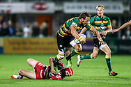 James Wilson of Northampton Saints (centre) making a break during the Aviva Premiership match at Franklin's Gardens, Northampton<br /> Picture by Andy Kearns/Focus Images Ltd 0781 864 4264<br /> 05/09/2014