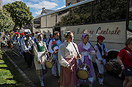 Bagad Pays de Abas from the town of Plabennec arrive at the Festival de Cornouaille on Saturday, July 23, 2016 in Quimper, France.