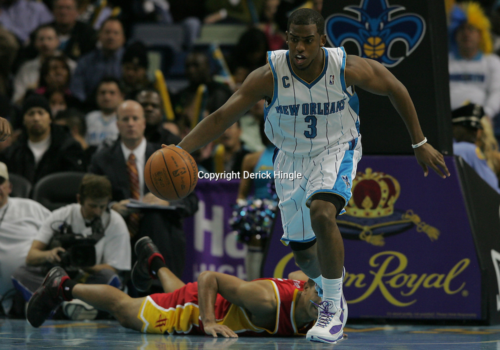 Jan 02, 2010; New Orleans, LA, USA; New Orleans Hornets guard Chris Paul (3) drives with the ball after a steal against the Houston Rockets during a game at the New Orleans Arena. The Hornets defeated the Rockets 99-95.  Mandatory Credit: Derick E. Hingle-US PRESSWIRE