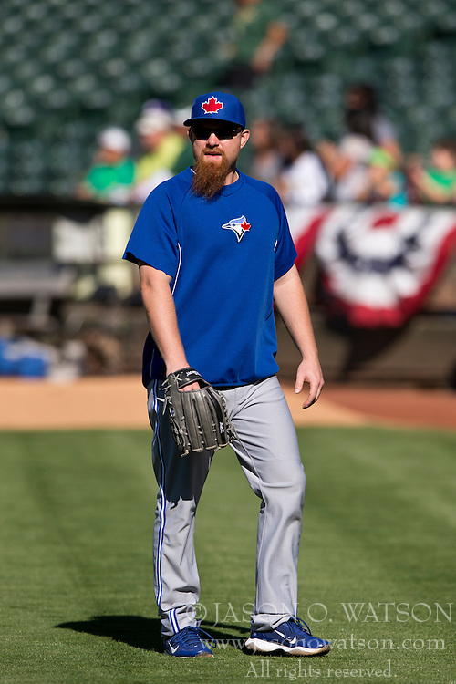 OAKLAND, CA - JULY 05:  Adam Lind #26 of the Toronto Blue Jays walks across the field during batting practice before the game against the Oakland Athletics at O.co Coliseum on July 5, 2014 in Oakland, California. The Oakland Athletics defeated the Toronto Blue Jays 5-1.  (Photo by Jason O. Watson/Getty Images) *** Local Caption *** Adam Lind