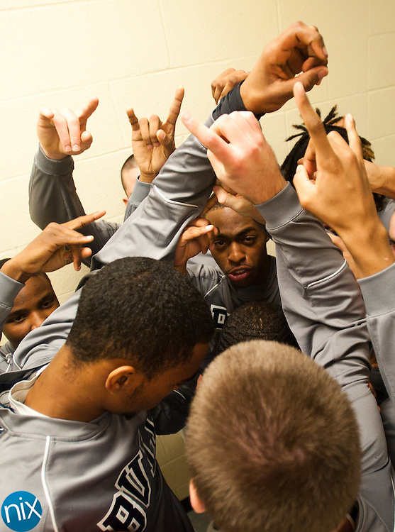 Hickory Ridge huddles up prior to a game against Central Cabarrus Tuesday night in Harrisburg. The Ragin' Bulls won the game 84-63.  (photo by James Nix)
