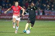 Macclesfield Town forward Arthur Gnahoua challenged by Salford City defender Liam Hogan during the EFL Sky Bet League 2 match between Salford City and Macclesfield Town at the Peninsula Stadium, Salford, United Kingdom on 23 November 2019.