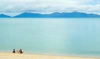A tourist couple soaking in the warm waters of the Gulf of Thailand on a beach on Ko Samui.  Ko Phangnan on horizon&#xA;<br />