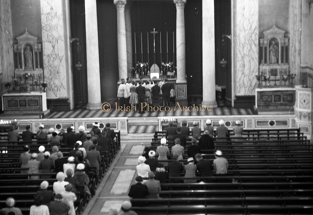 08/10/1959<br /> 10/08/1959<br /> 08 October 1959<br /> Wedding:Kenny - Colgan  (Muriel? and Tommy) at Church of St. Vincent de Paul, Griffith Avenue and the Grand Hotel, Malahide, Dublin. View of the wedding service.