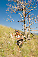 Woman hiking with Australian Shepherd dogs in mountains outside Livingston, Montana, <br /> MODEL RELEASED, PROPERTY RELEASED
