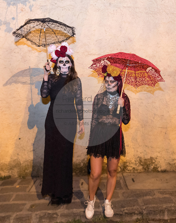Woman dressed as La Calavera Catrina during the Day of the Dead festival November 1, 2016 in San Miguel de Allende, Guanajuato, Mexico. The week-long celebration is a time when Mexicans welcome the dead back to earth for a visit and celebrate life.