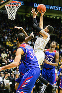 December 7th, 2013:  Colorado Buffaloes freshman forward Dustin Thomas (13) rises for a shot in the second half of the NCAA Basketball game between the Kansas Jayhawks and the University of Colorado Buffaloes at the Coors Events Center in Boulder, Colorado