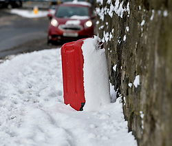 Pictured: An abandoned suitcase near a bus stop  in Edinburgh on Thursday morning.<br /> <br /> The severe winter weather continued to cause chaos throughout Scotland, with the most severe level of Amber warning being extended until 10am on Friday 02 March.<br /> <br /> © Dave Johnston / EEm