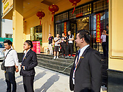 "13 FEBRUARY 2019 - SIHANOUKVILLE, CAMBODIA: Supervisors of Cambodian workers at the BWin Casino, a newly opened casino in downtown Sihanoukville, give a debriefing at the end of their overnight shift at the casino. There are about 80 Chinese casinos and resort hotels open in Sihanoukville and dozens more under construction. The casinos are changing the city, once a sleepy port on Southeast Asia's ""backpacker trail"" into a booming city. The change is coming with a cost though. Many Cambodian residents of Sihanoukville  have lost their homes to make way for the casinos and the jobs are going to Chinese workers, brought in to build casinos and work in the casinos.      PHOTO BY JACK KURTZ"