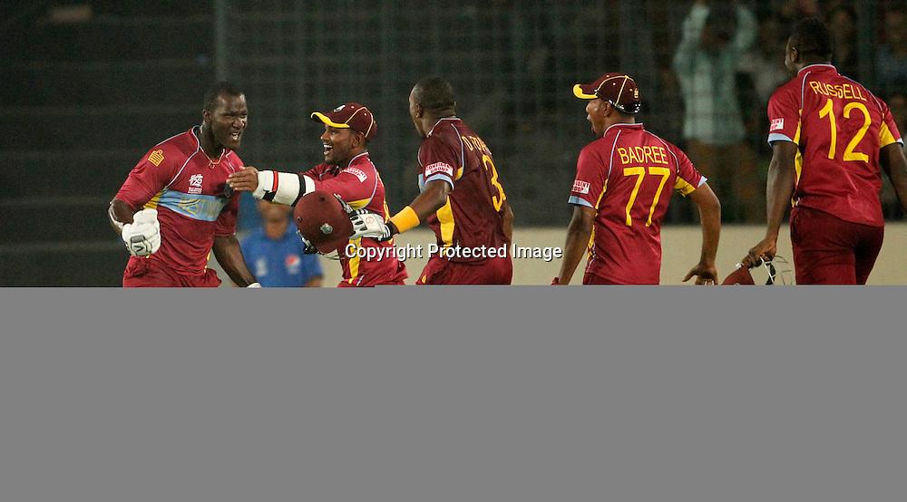 West Indies celebrate win over Australia - West Indies v Australia, ICC World Twenty20, Bangladesh 2014. 28 March 2014, Sher-e-Bangla National Cricket Stadium, Mirpur. Photo: Shamsul hoque Tanku/www.photosport.co.nz