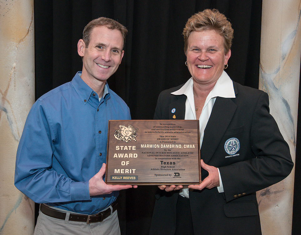 Houston ISD Athletic Director Marmion Dambrino, right, and Whataburger's Jeff Altman, left, pose with the NIAAA Kelly Reeves State Award of Merit presented to Dambrino at Texas High School Athletic Directors Association luncheon, March 3, 2014.