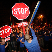 March 31, 2012 - Lexington, Kentucky, USA - University of Kentucky basketball fans beat and tear down stop signs as they celebrate their team's victory over the University of Louisville in Lexington, Ky., on March 31, 2012. The win for Kentucky advances them to the championship game of the NCAA tournament in New Orleans. Fans took to the streets and in burned couches, turned over a car and ending with a handful of arrests. (Credit image: © David Stephenson/ZUMA Press)