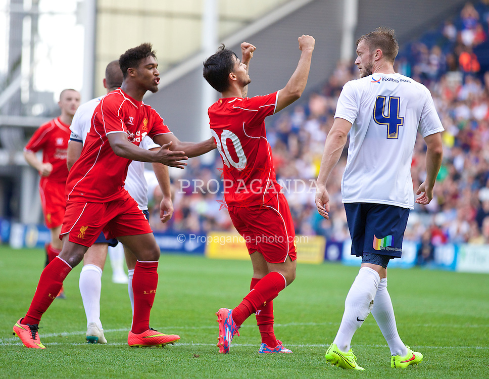 PRESTON, ENGLAND - Saturday, July 19, 2014: Liverpool's 'Suso' Jesus Joaquin Fernandez Saenz De La Torre celebrates scoring the first goal against Preston North End during a preseason friendly match at Deepdale Stadium. (Pic by David Rawcliffe/Propaganda)