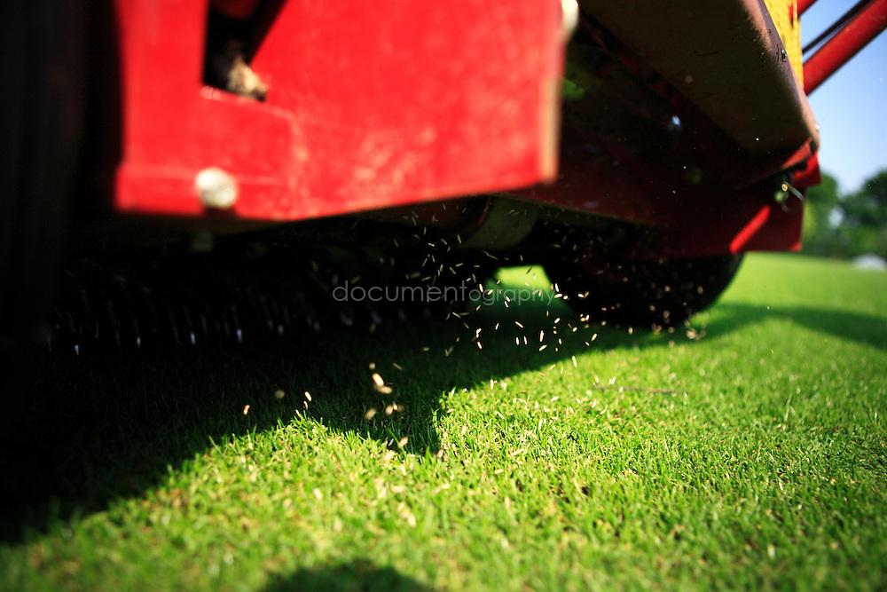 Gardeners tending grass of Wimbledon