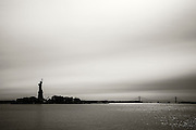 Statue of Liberty as seen from Libery State Park in New Jersey. Black and white.