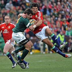 Jaque Fourie of the Springboks is tackled  Mike Phillips of the British and Irish Lions during the British and Irish Lions tour 2009