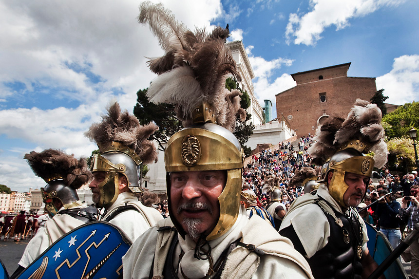 Ancient Roman costumed groups of people parade in the ancient areas of Colosseum , Circus Maximus and the Roman Forum to celebrate  the festivities of Christmas of Rome on April 22, 2012 in Rome, Italy. Legend says that Rome was founded by Romulus in 753 BC in an area surrounded by seven hills. Every year the city celebrates the Birth of Rome with parades and fighting in costume, re-enacting the deeds of the great ancient Roman Empire.