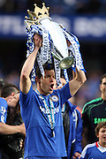 Chelsea's Michael Ballack celebrates with the Premier League trophy after they win the title with a 8-0 victory over Wigan Athletic in the English Premier League football match at Stamford Bridge, West London, England, on May 9, 2010. Chelsea finished the season one pont ahead of 2009 Champions, Manchester United.